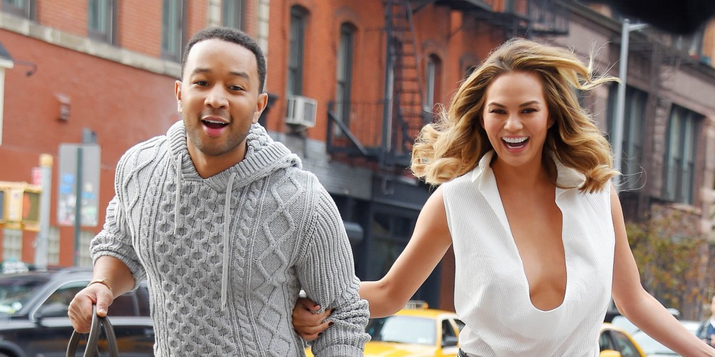 NEW YORK NY - DECEMBER 01: John Legend and wife Chrissy Teigen share sighting on December 1, 2014 in New York City.  (Photo by Josiah Kamau/BuzzFoto/FilmMagic)