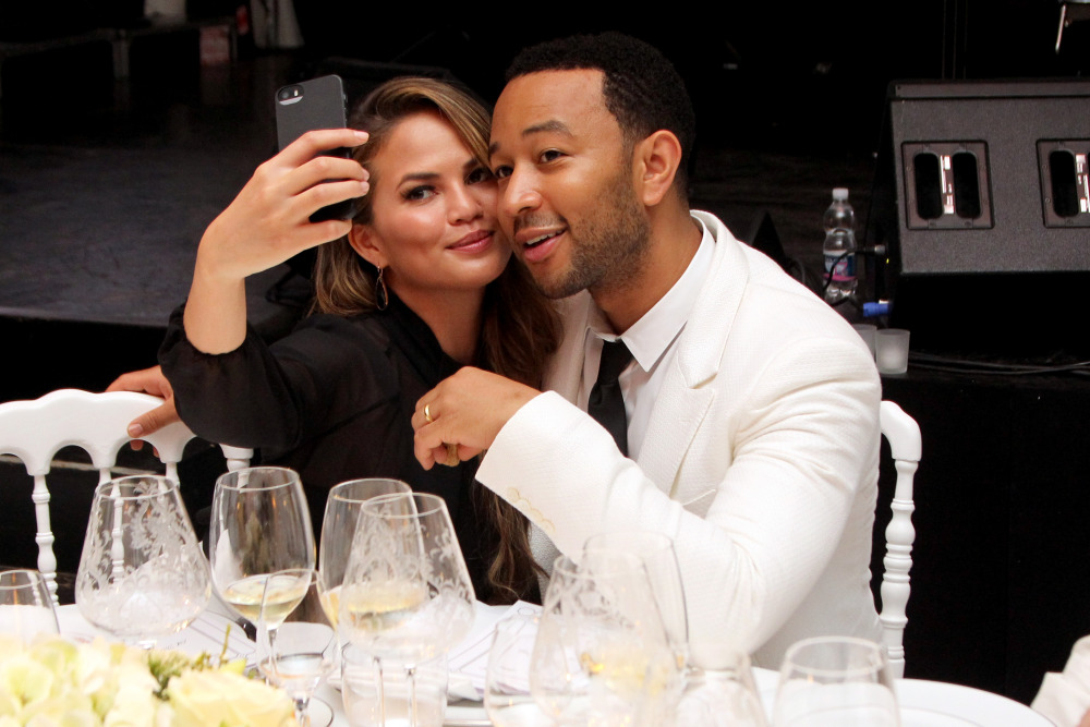 FLORENCE, ITALY - SEPTEMBER 05:  Chrissy Teigen and John Legend attend the White Party Dinner Hosted by Andrea and Veronica Bocelli Celebrating Celebrity Fight Night In Italy Benefitting The Andrea Bocelli Foundation and The Muhammad Ali Parkinson Center on September 5, 2014 at the Bocelli Residence in Forte dei Marme, Italy.  (Photo by Andrew Goodman/Getty Images for Celebrity Fight Night) ORG XMIT: 510863469 ORIG FILE ID: 454726944